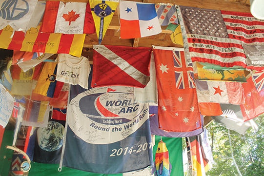 Flags hanging from the ceiling of the famous Suwarrow Yacht Club