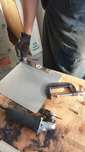 Old tangs were used to pattern new ones out of 316L stainless plate