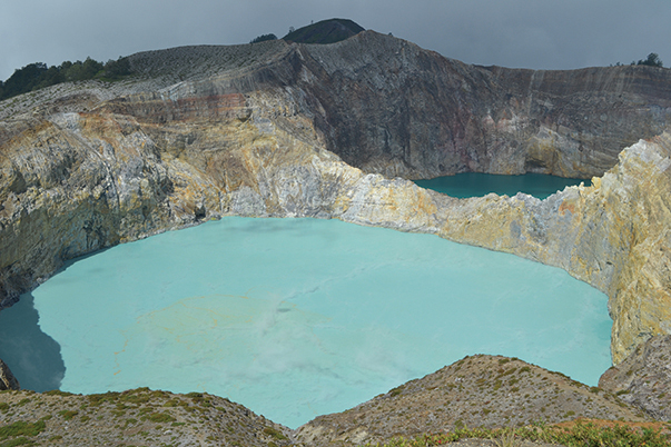 Pale and dark blue lakes, two of the three colored lakes of Kelimutu, Flores
