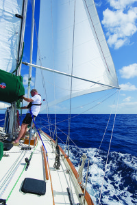 Joe Oots adjusts the topping lift as Worthless Wench works her way along the Bahama Banks
