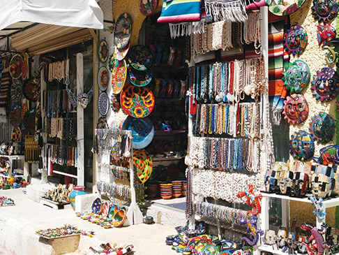 One of the many colorful shops where local craftsmen hawk their wares