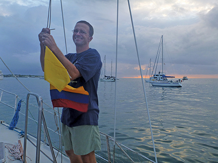 Markus hoists the Ecuadorian flag