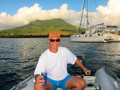 Neil relaxing in the Caribbean, Escapede in the background
