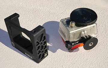 """The tripod adapter and the Unruly Headgear 'cage' next to it both allow for strong mounting using 1/4""""-20 bolts"""