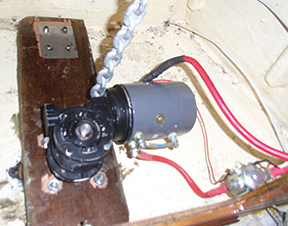 The reinforced under deck and windlass installation. The black heat shrink identifies the negative wire