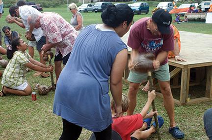 """Locals help visitors """"speed"""" husk coconuts"""