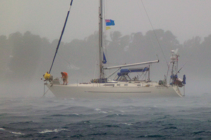 Once at the anchorage in Funafuti, Tuvalu, the Astarte crew set anchor in squally conditions
