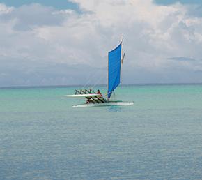 Flying the outrigger across Ninigo Lagoon