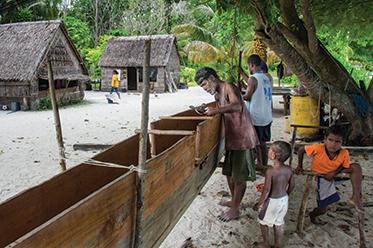 Thomas works on his new wa at Puhipi Village in Ninigo