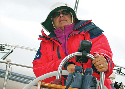 Vicki at the helm of our Pearson 36 cutter, Freelance