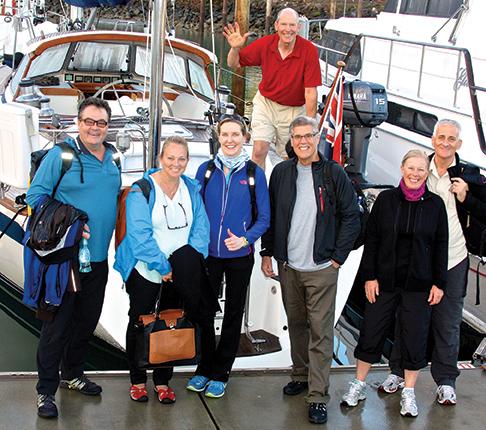 John Neal onboard Mahina Tiare III, with crew