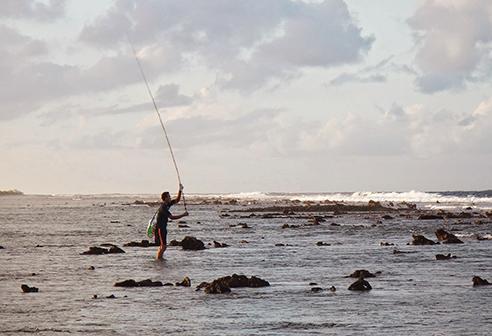 Sam fishing for grouper at sunset