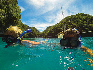 Jim and Katie going for a snorkel after securing Tenaya in the Rock Islands