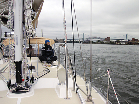 Susan bundled against the fall weather, enjoying the passage down the East River