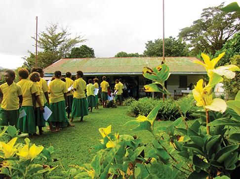 Students in line at a malaria screening clinic on Anatom Island in Vanuatu