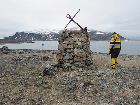 Haadon, one of Touche's crew, in Virgohamna next to the monument to the Swede Andree's attempt to reach the North Pole by hot air balloon around the turn of the 20th century
