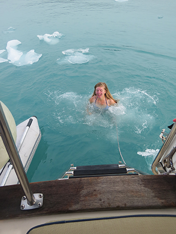 The author's niece Liv in Magdalena Fjord, in the water that is just above freezing. She had to push icebits out of the way.