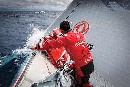 "May 19, 2015. Leg 7 to Lisbon onboard Dongfeng Race Team. ""If you go outside the gulf stream, you are out of the game"" says Charles Caudrelier. Jin Hao Chen 'Horace' on the bow pulling down the second headsail."