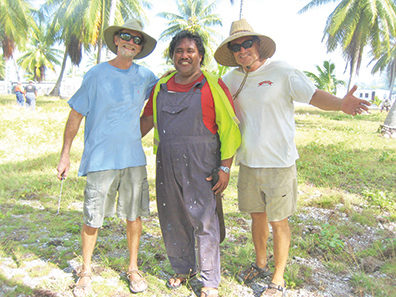 Author and freind John from SV Ruby Slippers with Rio, Penrhyn Atoll's gregarious host