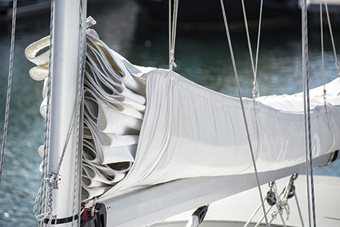 Detail image of mast and sail system on yacht sailboat