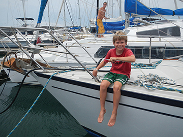 Snug in a marina in Brisbane after a tricky passage, Nicky refills the water tanks
