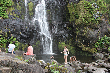At the base of the waterfall the entire music grup from the previous night's concert and their families were swimming and frolicking in the water
