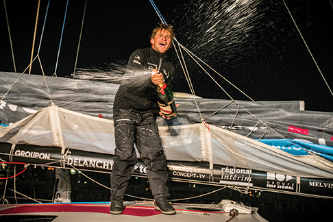 NEW YORK, NY - MAY 20: At 03:12 BST, Solidaires en Peloton-ARSEP skipper Thibaut Vauchel-Camus crossed The Transat bakerly finish line first in New York, taking line honours in the highly competitive Class40 division. Covering a total 3804nm between Plymouth and New York, the 37-year-old sailor was greeted by the iconic Manhattan skyline and Lady Liberty herself after 17 days, 12 hours, 42 minutes and 56 seconds at sea. May 20, 2016 in New York Harbor outside New York City.  (Photo by Lloyd Images / Amory Ross)